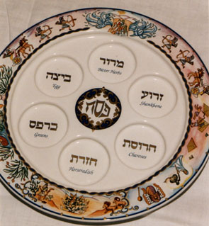 Seder dish, with places for the items and Passover motifs.